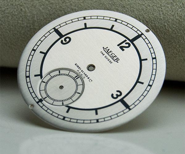 Restauración esfera reloj Jaeger Fab Suisse Kirby Beard Cº Paris